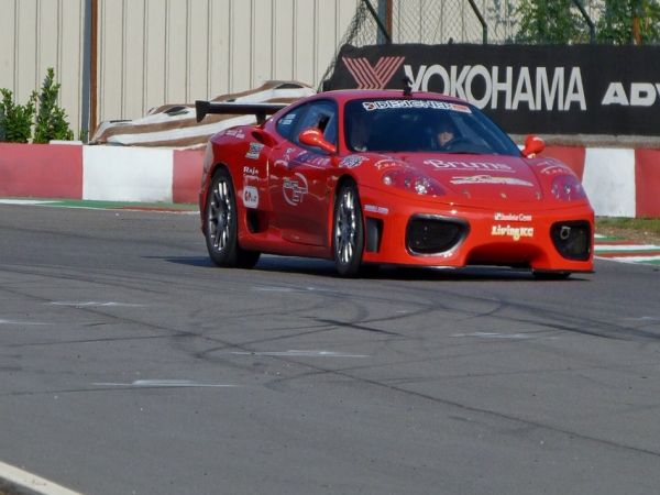 Driving sports cars on the race track by yourself