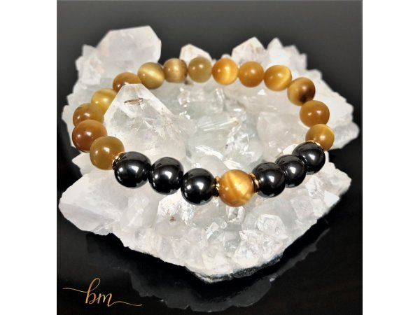 The eye of the tiger gold and hematite